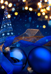 Christmas background with a christmas ornament on blue background